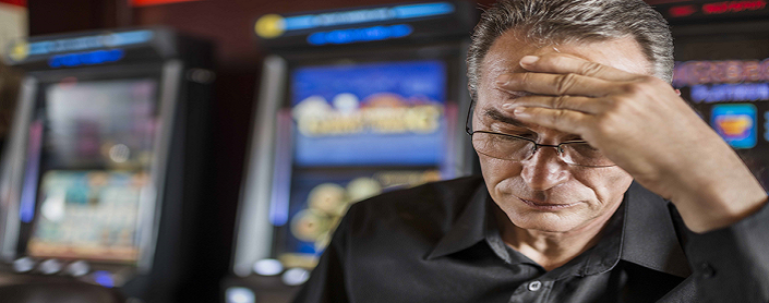 Older man who looks stressed at a casino